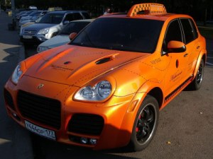 porsche cayenne - orange moscow luxury taxi